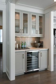Contemporary Living Room Bar Nook Filled With Glass And Cool Cabinet  #TransitionalDecor