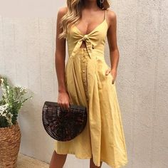 Get Sienna Millers style with this bow tie mellow yellow summer dress and pair with a wicker bag. Short Beach Dresses, Summer Dresses, Mini Dresses, Tie Up Dress, Stylish Summer Outfits, Backless Maxi Dresses, Mellow Yellow, Fashion Outfits, Fashion Trends