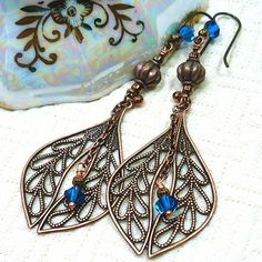 Beautifully complex earrings using multiple shapes and textures in these long, BOHO, antique copper, dangle earrings.  I began with antique copper laurel leaf filigree links with textured leaves symme