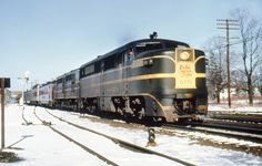 New Haven Railroad DER-3a ALCO PA-1 locomotive # 0771 & a DER-1 ALCO DL-109, is seen hauling a passenger train along the Shore Line in the snow at an unknown location during the mid 1950's, Mac Seabree Collection | Flickr - Photo Sharing!