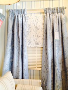 Laura Ashley blue and white pussywillow curtains and Roman blind.