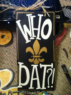 6x12 Who Dat New Orleans Saints Hand Painted Wood Sign with Fleur de Lis, Decoration, Door Hanger, Welcome Sign. $33.00, via Etsy.