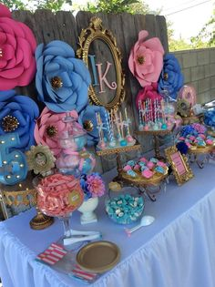 Such a beautiful pink and blue garden party! Love the paper flower backdrop! So popular at the moment. See more party ideas at CatchMyParty.com