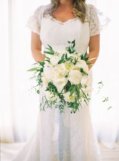 Traditional ivory bouquet: http://www.stylemepretty.com/2015/08/31/shades-of-blue-santa-barbara-wedding/ | Photography: Jessica Burke - http://www.jessicaburke.com/