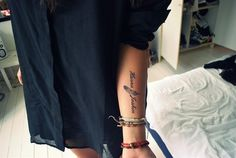 tattoo with names and feather