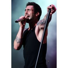 Maroon 5 rocks fans at F1 concert ❤ liked on Polyvore
