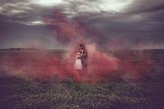 Smoke Bomb Red, Engagement photo, Stormy Day in the Prairies, Winnipeg, Manitoba. Unique couple pic idea. www.allypapko.com Ally Papko Photography & Design