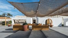 kapsimalis architects transforms abandoned lot into an open market in santorini
