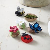 Garden Buddies Rock Cozies - A crafty way to make a paperweight or decorate your garden, from Love of #Crochet magazine