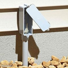 Say you want to hide a key How about mounting a phony plastic LB fitting? Screw it to the wall and run a bit of 1/2-in. conduit to the ground so it looks official. Cut the head off the bottom screw and glue it in place. That's it. Swing the cover aside and there's the key.