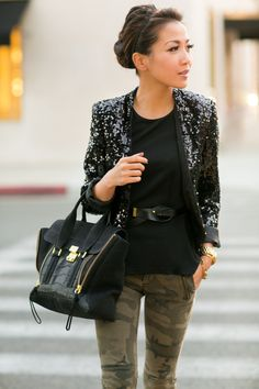 Pair a black sequin blazer with olive camouflage slim jeans to achieve a chic look.  Shop this look for $171:  http://lookastic.com/women/looks/skinny-jeans-satchel-bag-watch-belt-sleeveless-top-blazer/6801  — Olive Camouflage Skinny Jeans  — Black Suede Satchel Bag  — Gold Watch  — Black Leather Belt  — Black Sleeveless Top  — Black Sequin Blazer