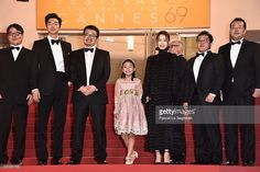 Actor Yoo Gong, (3rd-L) Director Sang-ho Yeon, (C) Soo-an Kim, (3rd-R) Actor Jung Yoo-Mi and guests attend the 'Train To Busan (BuSan-Haeng)' premiere during the 69th annual Cannes Film Festival at the Palais des Festivals on May 13, 2016 in Cannes, France.