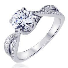 La bague de fiançailles Alessandra est un magnifique solitaire rond accompagné de diamants blancs. La forme entrelacée du corps de bague lui apporte de l'originalité et de l'élégance. Découvrez la sur notre site Internet: http://www.zeina-alliances.com/solitaire-platine-et-diamants/808-alessandra.html