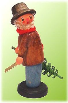 Erzgebirge German Wood Miniature Christmas Tree Cutter Handcrafted in Germany | eBay...I bought a little doll that looks SO much like this in an antique shop...I thought he looked German, but he has no markings.
