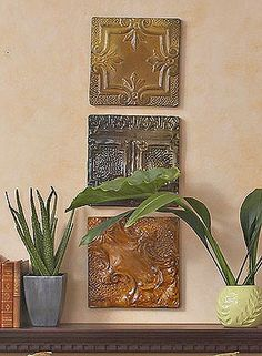 Instead of hanging a mirror or framed art, purchase old ceiling tiles from an architectural salvage dealer. Simply add hangers to the backs and mount them on the wall for a finished look