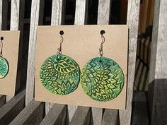 cookie cutter earrings made with air dry clay and stamps for texture. gotta try these!