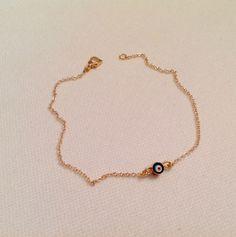 A personal favorite from my Etsy shop https://www.etsy.com/listing/236362988/tiny-bead-gold-braceletevil-eye-charm