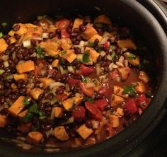 hearty vegetarian meal with sweet potatoes, black beans, tomatoes, garbanzos, onions, garlic, cilantro, lime,