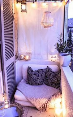 This is an outdoor nook. It is tiny, and there isn't much you can do with it. Except this. I have never seen such a great use of space. Picture all of the things you can do out here: date night, stargazing, watching a movie through a projector on that back sheet... The possibilities are endless! If I have one of these small outdoor spaces, this design will definitely be there!