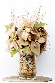 Compliment your Thanksgiving Table and wow your guests with this beautiful DIY Burlap Poinsettia Centerpiece. This floral arrangement can be crafted in only a few hours using products found at Walmart. Personalize it by adding a glitter letter ornament of your family initial.