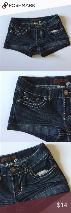 """Free Culture Stretch Jean Shorts Excellent condition. Dark wash. Stretch. Low rise. Contrasting stitching. Most of the stitching is fine, but there are a couple of spots that it's starting to come loose. Size 7.  86% cotton, 12% polyester, 2% spandex. Waist about 29"""", rise about 7.5"""", inseam about 1.5"""". Not from a smoke free house. 306 Free Culture Shorts Jean Shorts"""