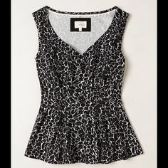 Anthropologie Top Preloved, in excellent condition! No rips, no stains, no holes, no discoloration or fading. Adorable sleeveless peplum top by Deletta for Anthropologie. Black and white pattern. Fits true to size. Anthropologie Tops