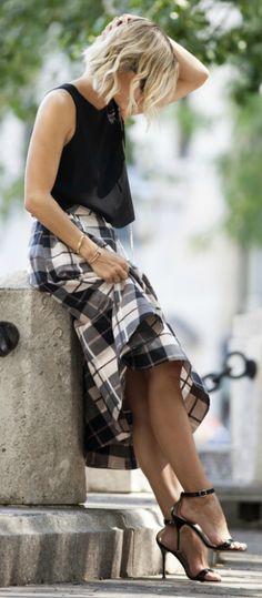 Jacey Duprie wears gorgeous plaid midi skirt with plain black vest top and heels.   Skirt: Kate Spade, Top: Club Monaco.