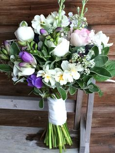 Bridal bouquet with tulips, ranunculus, stocks and narcissus