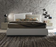 Meeting_up bed with padded storage base upholstered with Tranzerelle Tecnopelle and Visconti fabric. I-night system inclinART night stand in matt beige..