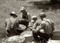 Picnic: August 1940 near Bardstown, Kentucky. Parishioners peeling potatoes for a benefit picnic supper on the grounds of St. Thomas Church. 35mm negative by Marion Post Wolcott for the Farm Security Administration.