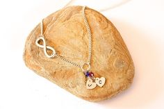 Personalised necklace with birthstones and infinity symbol. £14.00 by Thistledown Wishes on Etsy and Folksy