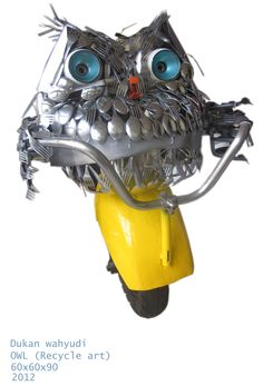 owl made from cutlery, vespa wheels, saws, etc.