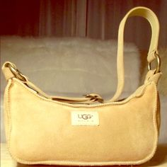 Ugg Australia Hand Bag Ugg Australia handbag that is small with lots of life.. You would absolutely ❤️•100% Authentic• UGG Bags Mini Bags