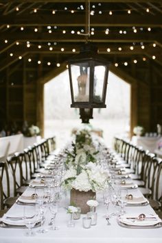 White Centerpieces in Barn Wedding | photography by http://www.ashleyseawellphotography.com