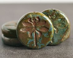 Hey, I found this really awesome Etsy listing at http://www.etsy.com/listing/151124619/forest-greens-dragonfly-23mm-czech-glass