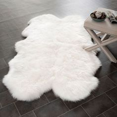 Add a country flare to your home with this white shag rug. This shag rug offers a unique shape and is made of authentic sheepskin hide and comfortable wool. The Prairie rug is by ultra-soft, and ready to look fantastic in your home. White Shag Rug, White Rug, White Area Rug, White Carpet, 4x6 Rugs, Sheepskin Rug, Rugs Usa, Dot And Bo, Home Living