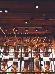 Touring the Starbucks Reserve Roastery & Tasting Room -- pictured are the copper pneumatic tubes the coffee travels through and into the silos.