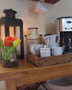 Like that tray for holding all the condiments. Tidy home coffee bar setup.