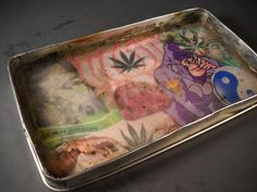 DIY collage weed tray in an old tin