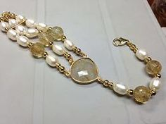 3 stands pearl and rutilated quartz hand knotted with a Quartz chanel and lobster clasp. One of a kind Item #944 $130.00