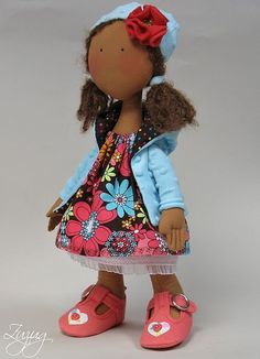 That is the cutest doll .... I would love one to look like my little girl.