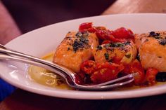 salmon with roasted tomatoes and oil cured olives