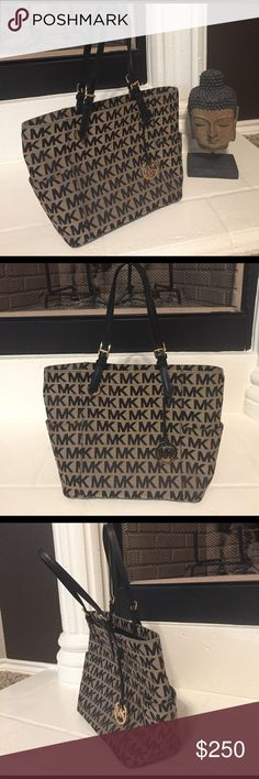 {Authentic} Michael Kors Jet Set Logo Tote Never been used!! Black MK logo tote bag! Extremely spacious bag with an inside zipper pouch. This bag is great for any day! Michael Kors Bags Totes