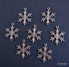 Pendentifs animaux, 2 breloques flocon de neige métal argenté 2.7 cm est une…