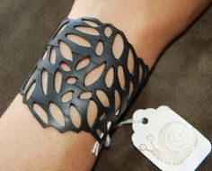inner tube cuff - you could make this by using craft punches!! Easy!