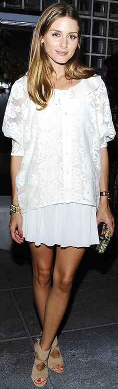 Olivia Palermo stuns in an all-white ensemble: white lace top, white skirt, and nude heels