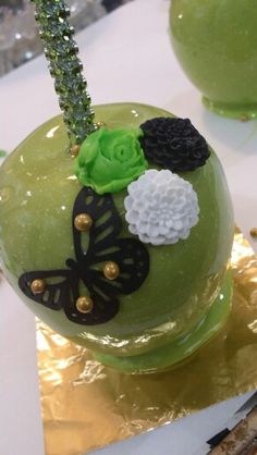 Lime Green candy apples,  black edible sugar butterfly with fondant flowers