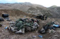 Swedish soldiers huddle together for warmth in Afghanistan. Photo credit: Försvarsmakten
