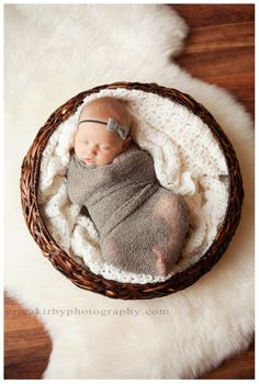 I love these newborn stretch knit wraps! Different colors... matching flowers. Newborn Stretch Knit Baby Wrap - Photography Prop - In Stock and Ready to Ship. $18.00, via Etsy.