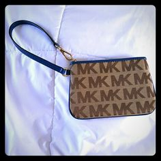 Tan and blue Michael Kors wristlet BNWOT Classic MK wristlet with gorgeous blue! Purchased brand new, never used. I thought it still had tags, but I must have taken them off. Michael Kors Bags Clutches & Wristlets